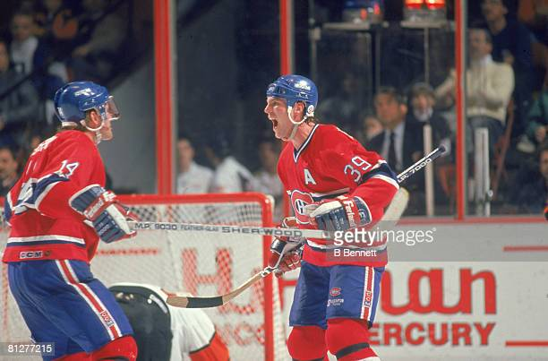 Canadian ice hockey player Brian Skrudland of the Montreal Canadiens celebrates on the ice with a teammate during a game against the Philadelphia...