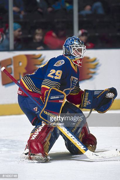 Canadian ice hockey player Bruce Racine goalkeeper for the St Louis Blues keeps a wary eye the action on the ice January 1996