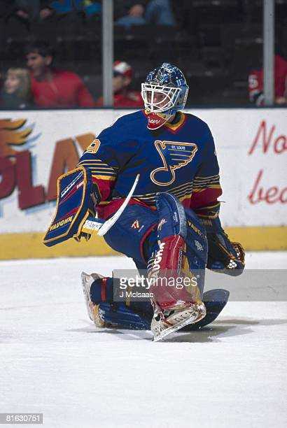 Canadian ice hockey player Bruce Racine goalkeeper for the St Louis Blues guards the net during a game January 1996