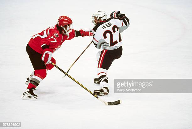 Canadian ice hockey player Cassie Campbell pushes US player Gretchen Ulion during the final game at the 1998 Winter Olympics The Americans win the...
