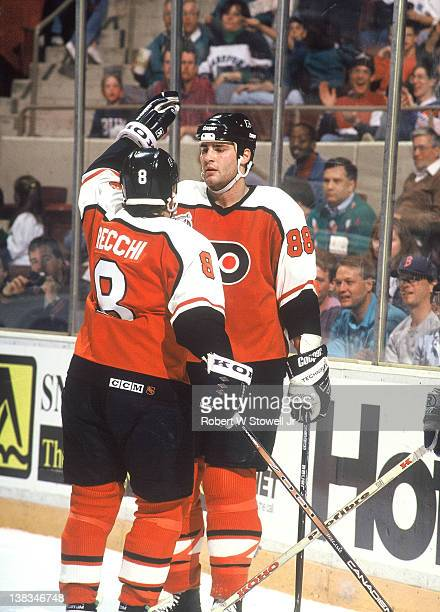 Canadian ice hockey player Eric Lindross and teammate Mark Recchi both of the Philadelphia Flyers celebrate a goal by Lindross during a game against...