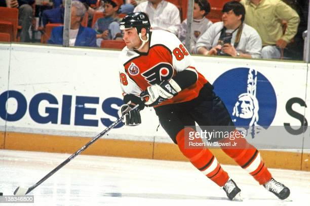 Canadian ice hockey player Eric Lindross of the Philadelphia Flyers with the puck during a game against the Hartford Whalers Hartford Connecticut 1992