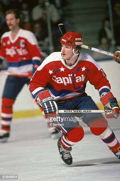 Canadian ice hockey player Gaetan Duchesne in the uniform of the Washington Capitals keeps his eyes on the action in a game against the New York...