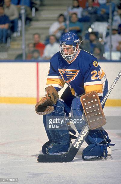 Canadian ice hockey player Greg Millen goalkeeper for the St Louis Blues defends the net during a game November 1989