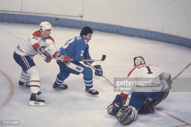 Canadian ice hockey player Jacques Richard of the Quebec Nordiques battles with Rick Wamsley goalkeeper for the Montreal Canadiens during a game...