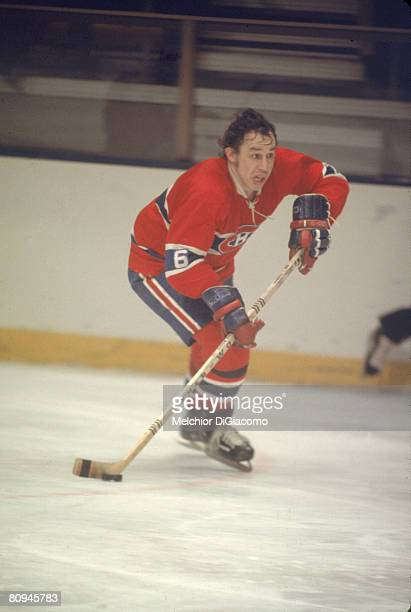 Canadian ice hockey player Jim Roberts of the Montreal Canadiens skates with the puck during a game 1970s