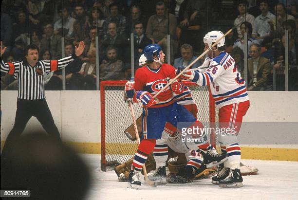 Canadian ice hockey player Keith Acton of the Montreal Canadiens squares off against Dave Maloney of the New York Rangers in front of the net during...