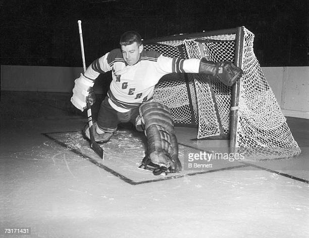 Canadian ice hockey player Lorne 'Gump' Worsley , goalkeeper for the New York Rangers, makes a save, late 1950s or early 1960s.