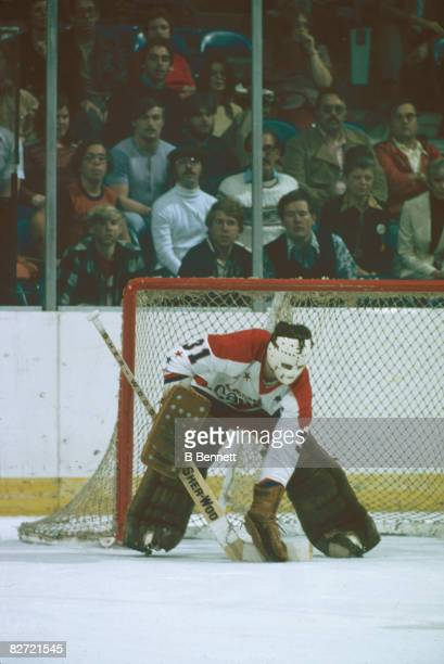 Canadian ice hockey player Michel Belhumeur goalkeeper for the Washington Capitals stops a shot during a game December 1974