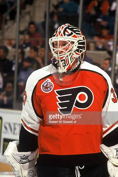 Canadian ice hockey player Pete Peeters goalkeeper for the Philadelphia Flyers on the ice during a game against Hartford Whalers Hartford Connecticut...