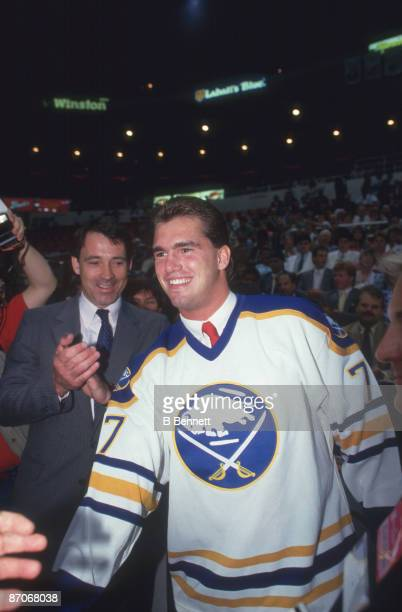 Canadian ice hockey player Pierre Turgeon smiles following his first round, first place selection by the Buffalo Sabres in the 1987 NHL Entry Draft...