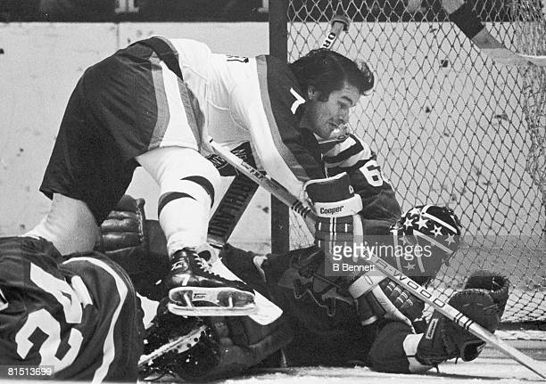 Canadian ice hockey player Rod Gilbert of the New York Rangers tangles with Dunc Wilson goalkeeper for the Pittsburgh Penguins in front of the...