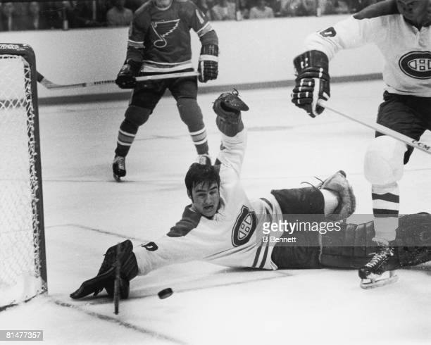 Canadian ice hockey player Rogatien Vachon goalkeeper for the Montreal Canadiens goes to the ice as he tries to stop a goal during a game against the...