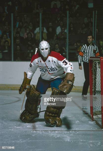 Canadian ice hockey player Ron Low goalkeeper for the Washington Capitals on the ice during a game April 1975