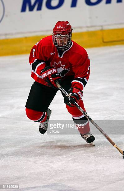 Canadian ice hockey player Sidney Crosby of team Canada skates with the puck in a game against Switzerland during the 2003 Under 18 Junior World Cup...