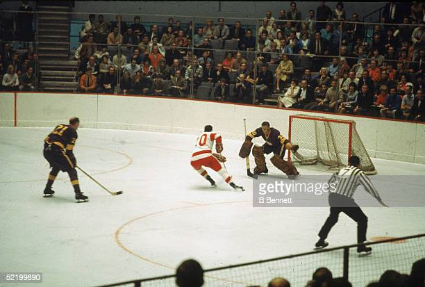 Canadian ice hockey player Terry Sawchuk goalkeeper for the Los Angeles Kings readies himself for a shot by an unidentified Detroit Red Wings player...