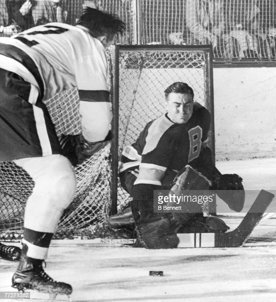 Canadian ice hockey player Tiny Thompson goalkeeper for the Boston Bruins closes his eyes as an opponant approaches with the puck 1930s