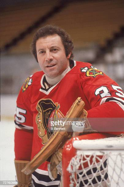 Canadian ice hockey player Tony Esposito goalkeeper for the Chicago Blackhawks as he leans on his goal late 1970s or early 1980s