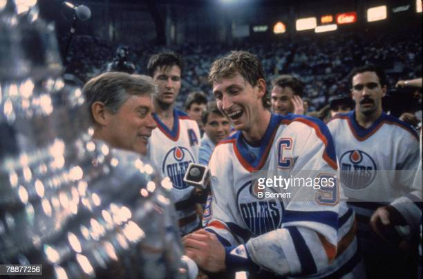 Canadian ice hockey player Wayne Gretzky of the Edmonton Oilers shakes hands with American National Hockey League Commisioner John Ziegler as he...