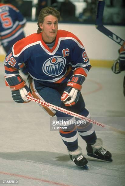 Canadian ice hockey player Wayne Gretzky skates on the ice, 1980s.
