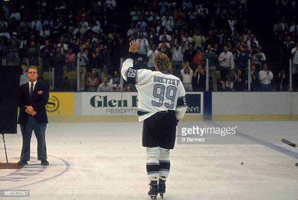 Canadian ice hockey player Wayne Gretzky waves to the crowd during an onice presentation October 1989