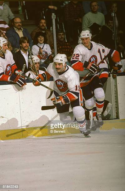 Canadian ice hockey players Bryan Trottier and Mike Bossy race onto the ice during a shift change in the middle of a game at Nassau Coliseum...
