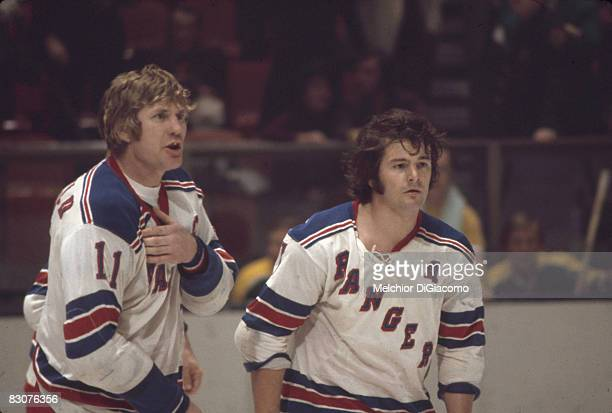 Canadian ice hockey players Vic Hadfield and Rod Gilbert of the New York Rangers on the ice 1960s or early 1970s