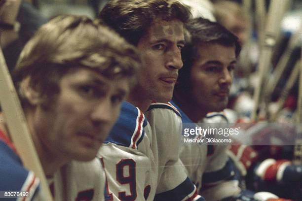 Canadian ice hockey players Vic Hadfield Jean Ratelle and Rod Gilbert of the New York Rangers sit together on the bench during a game 1960s or early...