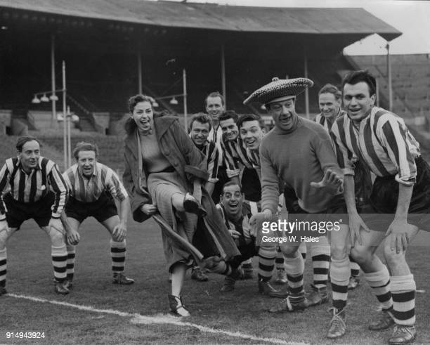 Canadian ice skater Jinx Clark kicks off during a football match between the cast of 'Babes in the Wood on Ice' at the Empire Pool Wembley and the...