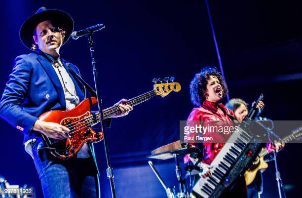 Canadian indie rock band Arcade Fire with lead singer and guitarist Win Butler and Regine Chassagne playing keytar perform on stage at Ahoy Rotterdam...