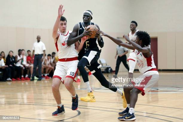 TORONTO ON JANUARY 11 Canadian Internation Basketball Academy forward Matur Maker drives the lane in his team's game against GTA Prep at Lifetime...