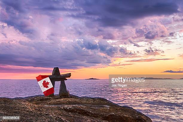 canadian inukshuk - flag of nova scotia stock pictures, royalty-free photos & images