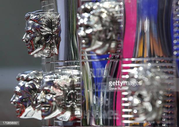 Canadian Jacques Villeneuve upper left is part of the Indy 500 Trophy at the North American International Auto Show at Cobo Center in Detroit January...