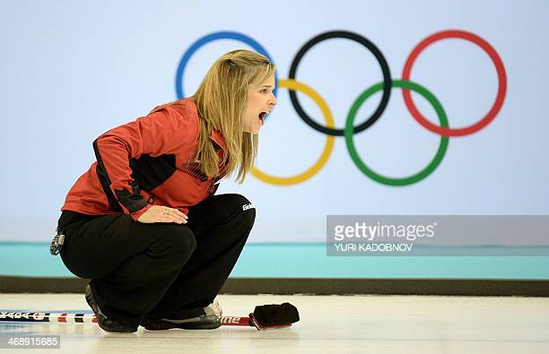 Canadian Jennifer Jones reacts as she throws the stone during the 2014 Sochi winter Olympics women's curling round robin session 4 match against...