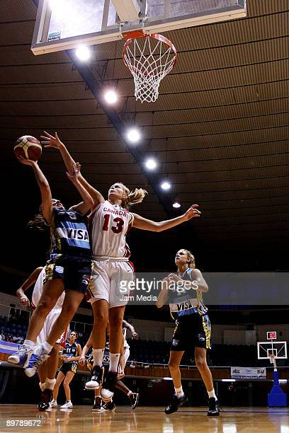 Canadian Jory McDonald tries to block the shoot of Argentinean Carolina Martinez during their FIBA U16 Americas Tournament semifinal match at the...