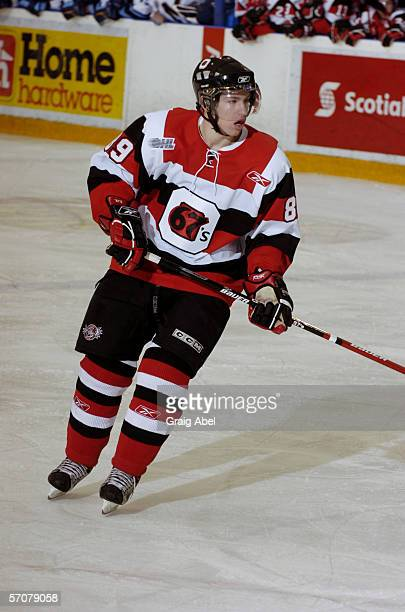 Canadian junior professional hockey player Logan Couture of the OHL's Ottawa 67's skates on the ice by an opponent during a road game against the...