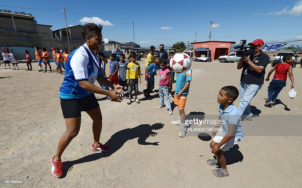 Canadian Karina LeBlanc (L), UNICEF goodwill ambassador, teach football techniques to children from low-income families in Tegucigalpa, on February 9, 2013. LeBlanc, the Canadian female football team goalkeeper, visited Honduras to encourage the practice of sports creating a safe environment for children as a way to prevent mistreatment and abuse. AFP PHOTO/Orlando SIERRA