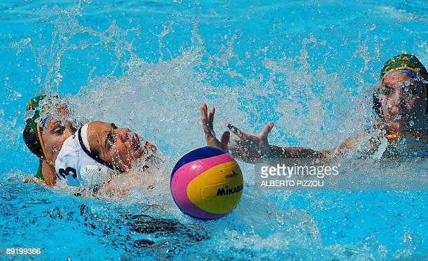 Canadian Katrina Monton fights for the ball with South African Marcelle Keet and Sarah Harris during the waterpolo game Canada vs South Africa on...