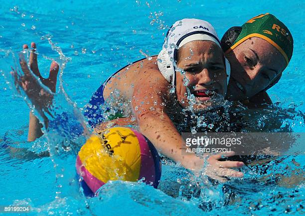 Canadian Katrina Monton fights for the ball with South African Delaine Christian during the waterpolo game Canada vs South Africa on July 23 2009 at...