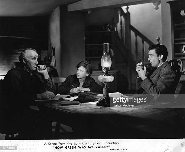 Canadian leading man Walter Pidgeon British child actor Roddy McDowall and British actor Donald Crisp are discussing matters in a scene from 'How...