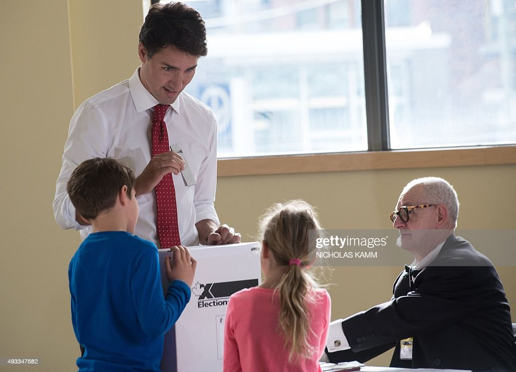 Canadian Liberal Party leader Justin Trudeau casts his ballot with his children in Montreal on October 19, 2015. The first of 65,000 polling stations opened Monday on Canada's Atlantic seaboard for legislative elections that pitted Prime Minister Stephen's Tories against liberal and social democratic parties. Up to 26.4 million electors are expected to vote in 338 electoral districts. Some 3.6 million already cast a ballot in advance voting a week ago, and the turnout Monday is expected to be high.