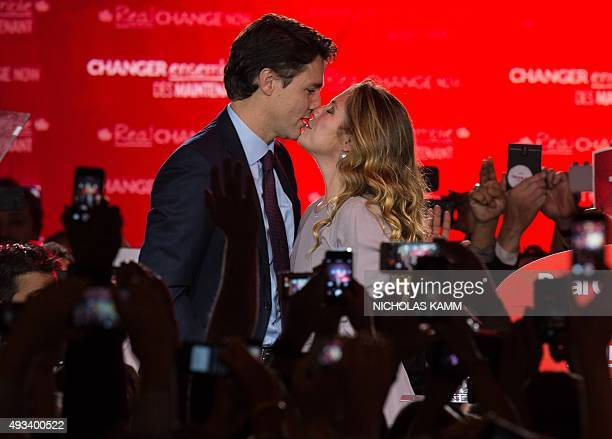 Canadian Liberal Party leader Justin Trudeau kisses his wife Sophie as they arrive on stage in Montreal on October 20 2015 after winning the general...