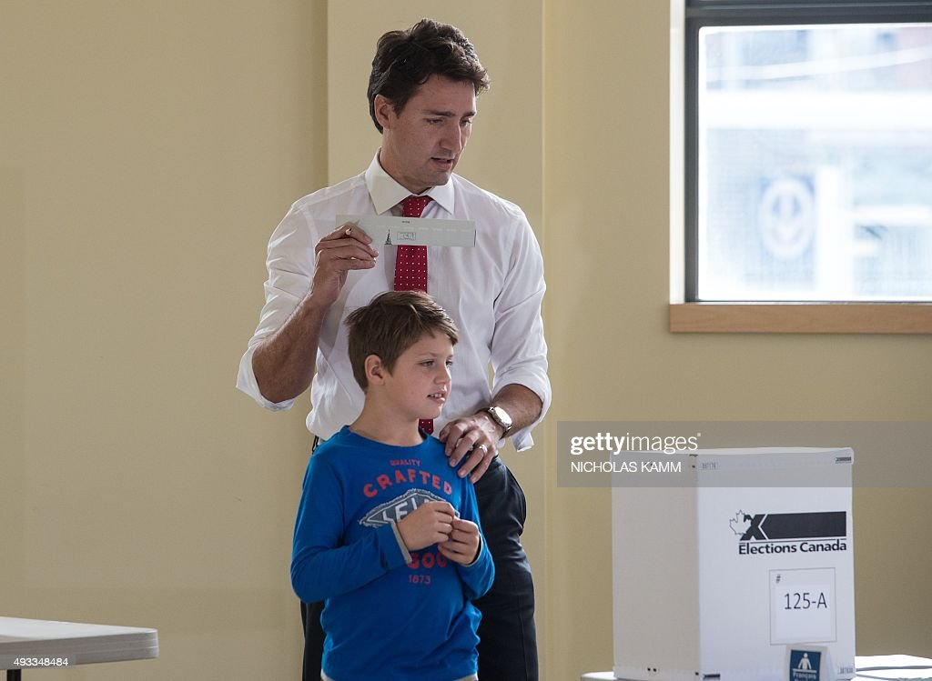Canadian Liberal Party leader Justin Trudeau walks with his son Xavier to cast his ballot in Montreal on October 19, 2015.The first of 65,000 polling stations opened Monday on Canada's Atlantic seaboard for legislative elections that pitted Prime Minister Stephen's Tories against liberal and social democratic parties. Up to 26.4 million electors are expected to vote in 338 electoral districts. Some 3.6 million already cast a ballot in advance voting a week ago, and the turnout Monday is expected to be high.