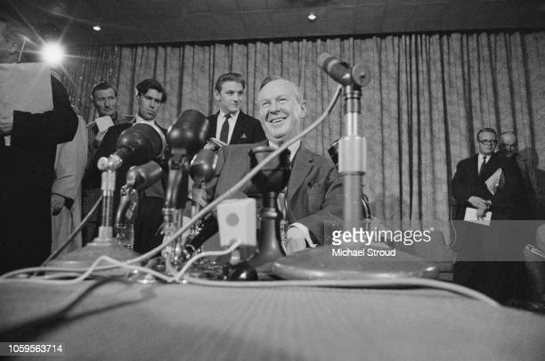 Canadian Liberal Party politician and Prime Minister of Canada, Lester B Pearson pictured seated in front of journalists at a press conference on 2nd...