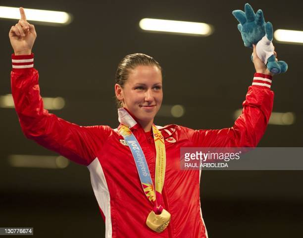 Canadian Mandy Bujold celebrates with her Gold medal after finish in the women's 51Kg weight final encounter during the XVI PanAmerican Games in...
