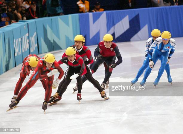 Canadian Marc Gagnon pushes teammate Jonathan Guilmette as Chinese Ye Li is shoved by Jiajun Li like US Daniel Weinstein and Italians Nicola Rodigari...