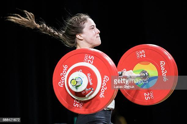 Canadian MarieEve BeaucheminNadeau competes in the clean and jerk portion of the women's 69kg weightlifting competition at the 2016 summer Olympic...