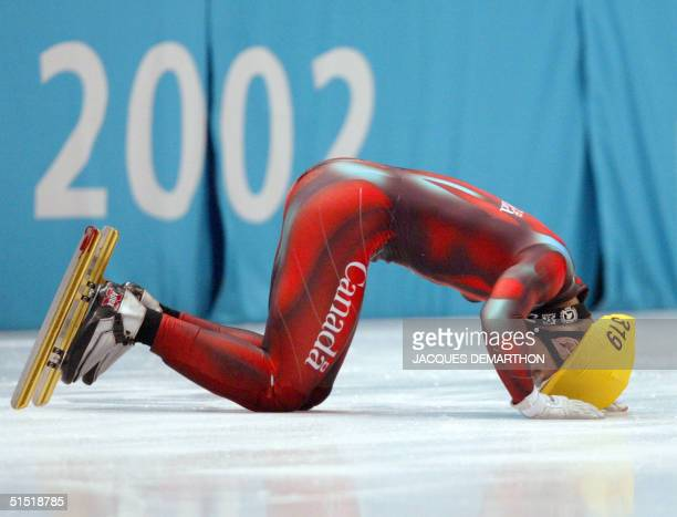 Canadian Mathieu Turcotte tries to get up after falling during the men's 1000m final short track race at the Olympic Ice Center 16 February 2002...