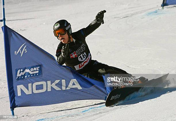 Canadian Matthew Morison competes in the Men's parallel giant slalom snowboard World Cup race in Limone Piemonte 08 December 2007 Austrian Manuel...