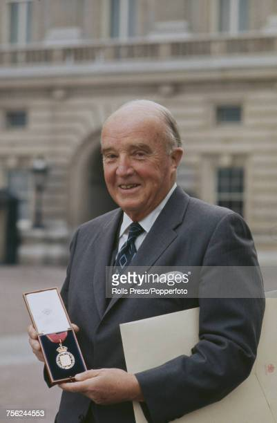 Canadian medical scientist and codiscoverer of the hormone insulin Charles Best pictured holding the insignia in the grounds of Buckingham Palace...
